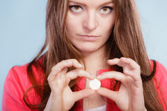 Woman with painkiller pill tablet. Health care. Stock Image
