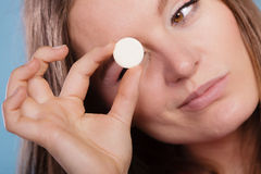Woman with painkiller pill tablet. Health care. Stock Photography