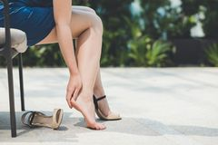 Woman pains from wearing high heel shoes. Woman pains heel from wearing high heel shoes. Health and medical concept Royalty Free Stock Images