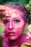Woman in paint. Attractive and sexy girl body art Royalty Free Stock Photos