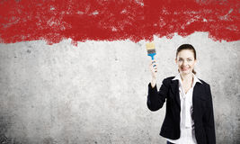 Woman with paint brush Stock Images