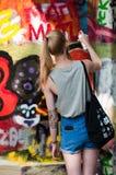 Woman paint a graffiti Stock Photography