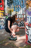 Woman paint a graffiti Royalty Free Stock Photography