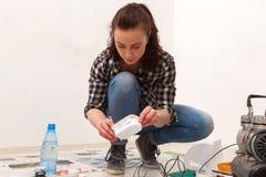 Woman paint little car stock images