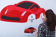 Woman paint little car stock photography