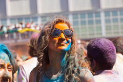Woman in paint pigments  at  Festival  Holi Barcelona Stock Images