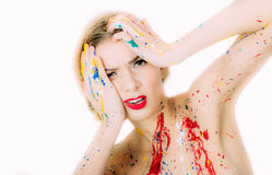 Woman in paint portrait with red lips making regret face Royalty Free Stock Photography