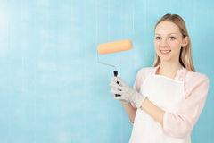Woman with paint roller Royalty Free Stock Photos