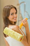 Woman with paint roller Stock Photos
