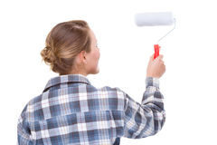 Woman with paint roller Royalty Free Stock Image