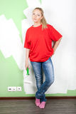 Woman with paint roller in hand Royalty Free Stock Photo