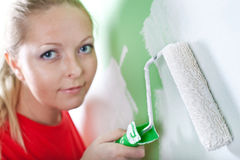 Woman with paint roller in hand Royalty Free Stock Images