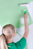 Woman with paint roller in hand Stock Photography