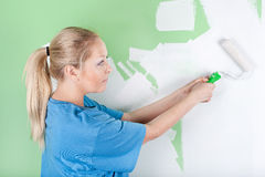 Woman with paint roller in hands Stock Image
