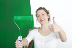 Woman with paint roller thumbs up Royalty Free Stock Photo