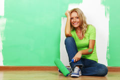 Woman paint on wall. Woman paints the wall brush Stock Photography