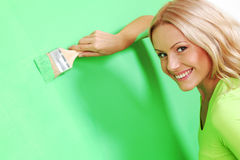 Woman paint on wall Royalty Free Stock Photo