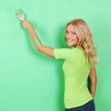 Woman paint on wall Royalty Free Stock Photos
