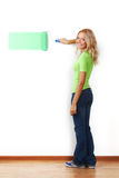 Woman paint on wall Stock Photo