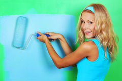 Woman paint on wall Stock Photos