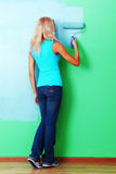 Woman paint on wall Royalty Free Stock Photography