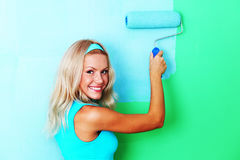 Woman paint on wall stock photography