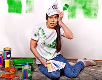 Woman paint wall at home. Royalty Free Stock Photo