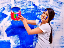 Woman paint wall at home Royalty Free Stock Photography