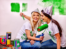Woman paint wall at home Stock Image