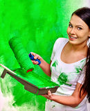Woman paint wall at home Stock Photos