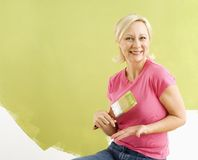 Woman with paintbrush. Stock Image