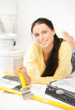 Woman with paintbrush and renovating tools Stock Photo