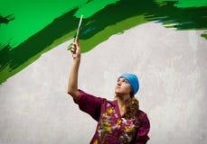 Woman with paintbrush Stock Photos