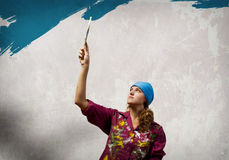 Woman with paintbrush Royalty Free Stock Photos