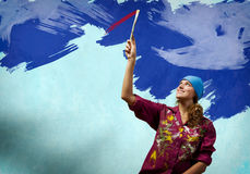 Woman with paintbrush Stock Images
