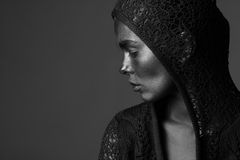 Woman painted with dark paint Stock Photo