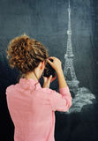 Woman and painted tower on chalkboard Stock Photography