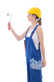 Woman painter in blue coveralls and yellow helmet isolated on wh Stock Image