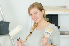 Woman painter with brush in hand. Woman stock photography