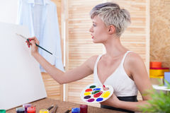 Woman painter with easel Royalty Free Stock Photos