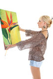 Woman painter with her picture over white Stock Photos