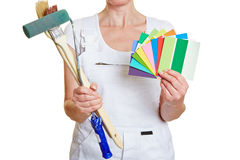 Woman holding brushes and color Royalty Free Stock Photos