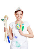 Woman in painter overall with color. Happy woman in painter overall with brushes and color fan Stock Images