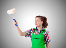Woman painter with paintbrush against gradient Stock Photo