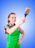 Woman painter with paintbrush against gradient Royalty Free Stock Photo