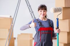 The woman painter painting in new apartment Royalty Free Stock Images