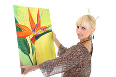 Woman painter showing her picture over white Royalty Free Stock Photos
