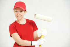Woman painter worker with roller Stock Images