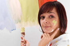 Woman painting Stock Images