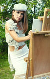 Woman is painting Stock Photography